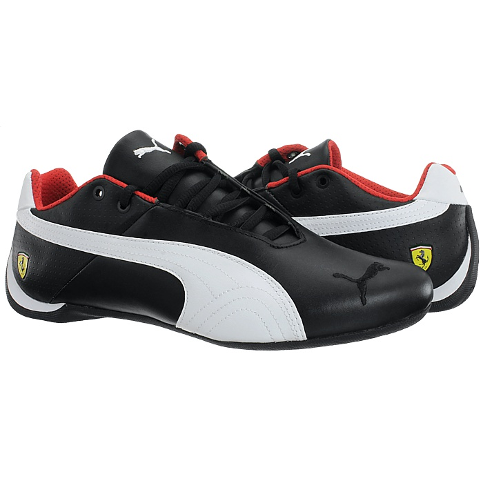 379dc6d42a4d0 Stylish sneakers out of the Puma racer family made of genuine leather with  Ferrari details